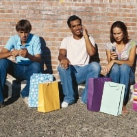 Young people sit with purchases